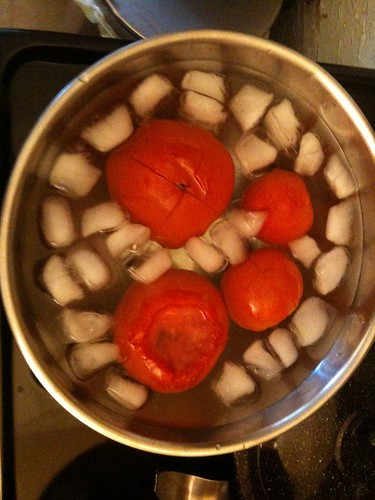 Blanching the tomatoes (this removes the skin)