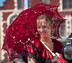 Woman in Red traditional dress (Luigi R. Viggiano) Tags: red portrait woman smile umbrella nikon europe belgium traditional brugge bruges nikkor reddress bruge belgio merlet 18200mm flickrduel d5000