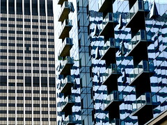 Living in a glass house (Dialed-in!) Tags: blue windows two reflection lines vertical horizontal oregon contrast portland downtown open angle many or stripes diagonal wires repetition balconies pdx wavy liquid wellsfargocenter dialedin