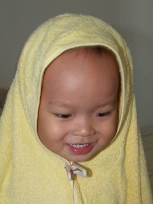 Justin in towel tudung