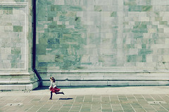 Always on the run (Village9991) Tags: red italy lake como church girl childhood stone wall italia alone power cathedral pillar silk running run skirt always romanic lario gotic