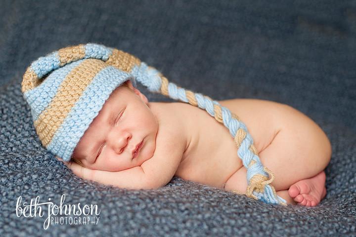 newborn baby boy in blue and brown elf hat