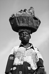 Lendu man carrying captain fish - DR CONGO - (C.Stramba-Badiali) Tags: africa portrait people lake fish man face rural person blackwhite fishing eyes village noiretblanc market expression african district albert traditional culture captain conflict blackpeople congo tradition ethnic plain humanbeing carry drc homme visage regard afrique kinshasa zaire plaine pche rdc drcongo humain onhead blackskin congolese centralafrica gety ethnie ituri peaunoire afriquecentrale surlatte lendu forgottenconflict similiki lenduman