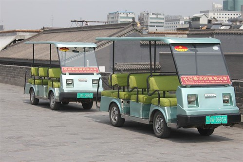 Sightseeing bus can be seen on Xi'an wall, China
