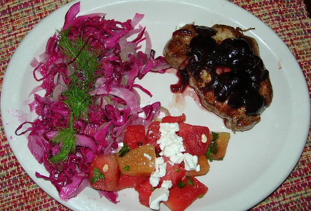 Center Cut Pork Chop with Savory Cherry Sauce, Red Cabbage and Fennel Slaw, Melon & Feta Salad
