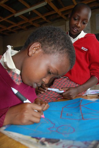 "A class 6 pupil during the drawing stage. The girls were prompted with themes of ""the importance of education"" or ""how will I use my education?"""