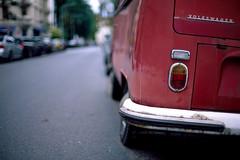 Volkswagen T2 (patrickbraun.net) Tags: old red car analog volkswagen bokeh slide westend transporter frankfurtmain t2 rvp50 olympusom4ti bokehlicious zuiko50mmf12 fujichromevelvia50professional