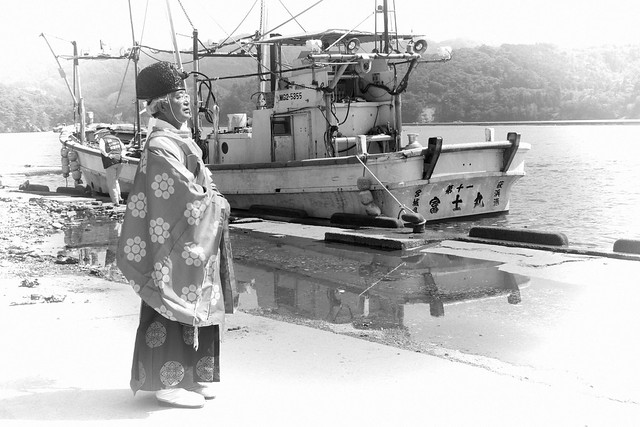 Shinto priest and fishing boat