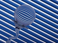 Bent Lines (Karen_Chappell) Tags: blue stilllife glass lines ball circle one bend stripes curves stripe orb line sphere round refraction curve tpc tpcu14 tpcu14l5 tpcu14l1