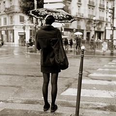 girl in black [explored] (doistrakh) Tags: street travel blackandwhite bw paris france 120 6x6 tlr film girl monochrome rain rolleiflex umbrella mediumformat square europe dof rainyday kodak bokeh 400tx vintagecamera 135 35e planar twinlensreflex carlzeiss trix400 f75mm vintageanalogue