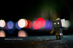 Walking on a line of bokeh (Martin-Klein) Tags: 50mm nightlights bokeh dsseldorf k danbo strobist