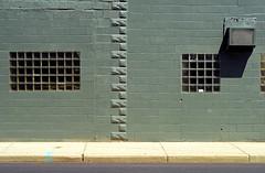 Indy#7825_Copy (Single-Tooth Productions) Tags: city windows urban building architecture composition grid 50mm nikon architecturaldetail indianapolis buildingdetail indiana airconditioner sidewalk nikkor streetview glassblock concreteblock urbanbuilding nikond200 neside nikkor50mmf18daf michiganst exteriorwall glassblockwindows architecturalcomposition paintedconcreteblock exteriorbuildingwall texturedconcreteblock wallmountedairconditioner buildingstreetview