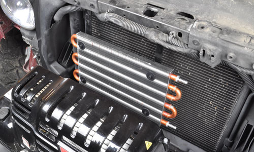 You'll need to make two simple straps to mount a Flex-a-lite PN 4118 transmission cooler on a 2007-2012 Jeep Wrangler. This should avoid any overheating problems with the automatic transmission.