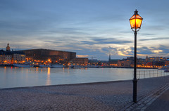 An Evening on Skeppsholmen IX (Henrik Sundholm.) Tags: street city bridge light sunset church architecture clouds buildings boats exterior sweden stockholm dusk palace cobblestone sverige skeppsholmen hdr gravel klarakyrka strmmen waterscape storkyrkan slottet constructioncrane jakobskyrka saintjamesschurch