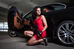 Bondgirl (STEFFEN EGLY) Tags: park red portrait sexy girl car umbrella canon gun dress garage bmw bond softbox strobe 3series brunett strobist 1585mm