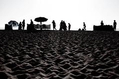 Beach (Che-burashka) Tags: ocean travel sunset summer vacation sun beach 50mm sand sandy silhouettes porto fantasy dreams leisure symbols umbrellas canonef50mmf14usm gettyiberiasummer