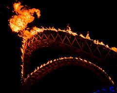 Tympani Lambada at night (Michael Prados) Tags: sculpture art fire led burningman propane truss flaminglotusgirls fireart structuralart burningman2011 tympanilambada curvedtruss