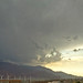 Jet plane flying into Palm Springs and into a thunderstorm from I-10 bridge on Indian Canyon Drive