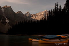 Ghostly Canoes at Moraine Lake (idashum) Tags: longexposure nightphotography trees lake canada lightpainting tree pinetree pine night clouds landscape nikon exposure bluesky alpine pines ida pinetrees shum banffnationalpark morainelake d300 glaciallake idashum idacshum