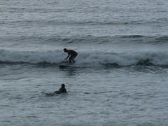 Surfers (Alan Travers) Tags: camping ireland sea beach silhouette reflections cow surf clare waves cliffs surfers hoof hurling snout lahinch hurl lehinch