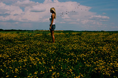 Turning your back (Chantel Baggley) Tags: girl field female clouds country bluesky blonde blackbirds yellowflowers sideways greengrass whiteclouds jeanshorts standingstraight teenagephotographer canonrebelxsi chantelbaggley