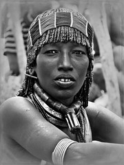 Hamer first wife (Linda DV) Tags: africa travel portrait people blackandwhite bw canon geotagged blackwhite clothing culture tribal jewellery clothes portraiture tradition ethiopia tribe ethnic minority hamar hamer 2010 ethnology banna powershots5is minorité minderheid lindadevolder