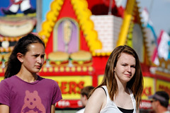 Two Girls Walking Through the Missoula County Fair (CT Young) Tags: montana candid streetphotography missoula countyfair gardencity candidportrait streetcandid missoulamt missoulamontana westernmontanafair westernmontana missoulacounty canonef70200mmf4lusm missoulafair missoulacountyfair 2011westernmontanafair