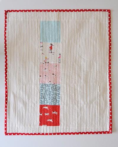 Sherbet pips crib quilt reverse