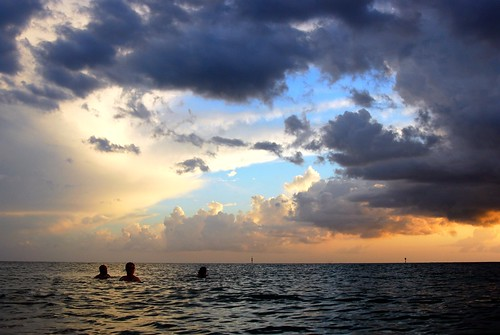 swimmers and sunset clouds