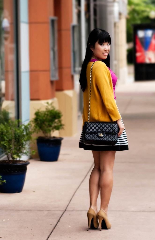 target mossimo mustard cardigan, the limited fuchsia cutout trim tank, forever 21 striped pleated skirt, mk5430, charlotte russe pearl bib necklace, forever 21 mustard pumps, chanel quilted classic lambskin m/l flap purse