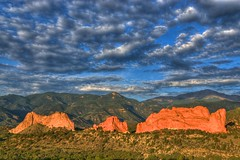 Sunrise at the Garden of the Gods (Thad Roan - Bridgepix) Tags: blue red sky mountain nature clouds sunrise landscape photo sandstone colorado rocks image picture gardenofthegods coloradosprings gateway rockymountains geology pikespeak facebook kissingcamels hogback