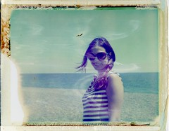 Her Majesty, the Queen of Summer Jewels (lyconaut) Tags: sea portrait film beach analog polaroid stripes lofi crete messy land instant brunette expired jewel 340 packfilm iduv lcnt