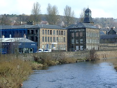 WULTIN MILL. 02 (the water watcher 05.) Tags: blue trees houses winter sky brown white tree green tower cars mill clock water pool wall architecture clouds buildings river march scotland town stream poplar skies factory village bluesky clocktower rapids vans stonewall blueskies salmonriver wintertime riverbank oldmill townscape willows commercialroad borders waterscape hawick whiteclouds teviot scottishborders roxburghshire riverscape teviotdale riverteviot textilemill fujifinepixs6500fd wiltonmills brokenwater dicksonsandlaings wultin thegreyauldtoon lombardleypoplar riverbanktrees teviotvalley teviotwater wultinmill laingspool seatroutriver
