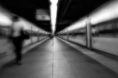 Catching the Train (Chuck Robinson) Tags: newyorkcity blackandwhite newyork lensbaby subway nikon trains grandcentralstation grandcentral 2011 plasticoptic silverefexpro2
