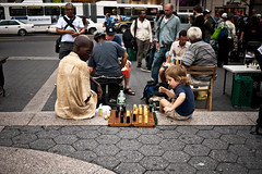 Master and pupil (sjmgarnier) Tags: street newyorkcity boy people urban playing newyork man stairs kid student sitting child adult manhattan september teacher sidewalk master checkers portfolio unionsquare littleboy focused checker pupil littlekid winning losing draught draughts 2011 sittingonstairs colorstreetphotography playingcheckers