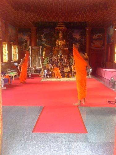 Monks adjusting their clothing