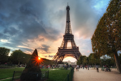 Sunset at The Eiffel Tower (TheFella) Tags: park pink blue trees sunset red sky people sun paris france slr tower grass yellow clouds digital photoshop canon landscape eos photo high iron europe ledefrance cityscape dynamic dusk path eiffeltower landmark fair eiffel icon photograph hedge latoureiffel champdemars processing worlds 5d dslr range hdr highdynamicrange lattice worldsfair markii gustave eiffeltour postprocessing rpubliquefranaise promote gustaveeiffel photomatix frenchrepublic rgionparisienne parisregion theironlady ladamedefer 5dmarkii promotecontrol puddlediron