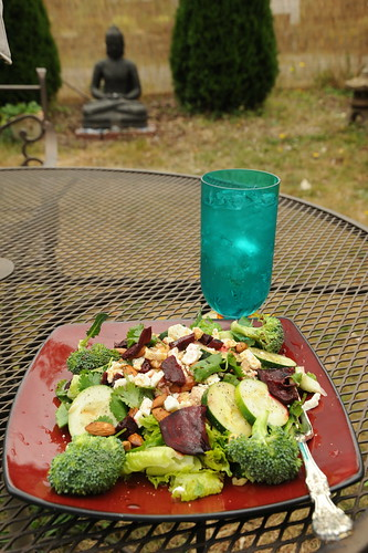 Healthy eating: Summer salad with a tumbler of sparkling water, blessed Buddha statue, outside in the yard, Broadview, Seattle, Washington, USA by Wonderlane