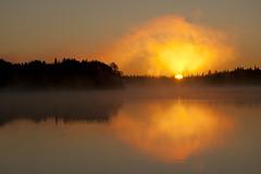 Atomic Sunrise (Canadapt) Tags: morning orange lake reflection silhouette sunrise glow keefer canadapt