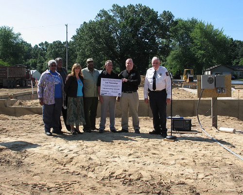 From left: Township Treasurer Jessie Lowery, Trustee Steve Black, Township Clerk Jackie King, Township Trustee Bruce Ferguson, Township Supervisor Steve Miller, USDA Rural Development Specialist Paul Bristol, Fire Chief Nelvin DeWeerd.