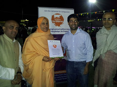 Presenting pledge certificate and HH Radhanath Swami signed leaflet