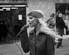 lady sings the blues (Andre Delhaye) Tags: street uk girl hair manchester lumix photography photographer singing wind song candid andre panasonic blond g3 performer 43 csc m43 mft mirrorless delhaye micro43 microfourthirds 43 wwwandredelhayecom wwwandredelhayenet lumixg3 dmcg3 panasonicg3 andredelhayephotographer streetphotographycandidstreetportrait