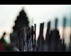 fence, pagoda and the praying man (PNike (Prashanth Naik..back after ages)) Tags: wood sky man fence temple nikon asia cambodia dof bokeh prayer praying siemreap firday hff padoga d7000 pnike