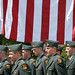With Old Glory waving in the background members of the NC State ROTC stand in formation.
