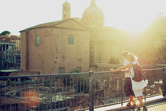 Rome at sunset (josemanuelerre) Tags: old sunset italy sun rome roma reflection building sol church yellow lens landscape atardecer golden ancient ruins couple italia bright roman pareja dusk forum edificio ruin paisaje tourist foro ruina amarillo ruinas descansar hour hora empire reflejo flare romantic rest lente viejo brillo destello turista irongate dorada verja imperio romntico igleia