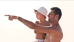 LOOKING SO FAR WITH DAD (*Marta) Tags: boy sea summer portrait baby sun sunlight game beach water hat fun kid child play looking skin joke father sunny together summertime contact safe embrace pointing tender swimminsuit gettyvacation2010 gettyimagesitalyq1 gettyimagesgreece1 gettygreecefamily gettyimagesitalyq2 gettygreecesummer
