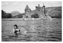 loch and castle (gorbot.) Tags: summer blackandwhite bw swimming trossachs roberta lochawe f19 kilchurncastle leicam8 digitalrangefinder ltmmount silverefex voigtlander28mmultronf19