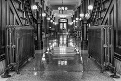 The Hallway of Pioneer Courthouse in Black and White - HDR (David Gn Photography) Tags: door blackandwhite reflection architecture oregon stairs portland woodwork raw antique columns monotone historic hallway lobby heater chandeliers panels lamps marble flooring federal radiator hdr legal courtroom 3xp courtofappeals canoneos7d thepioneercourthouse sigma2470mmf28ifexdghsm brandongodfrey sigma50th theninthcircuit