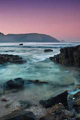Silent Moments (Jurjen Harmsma Photography) Tags: ocean africa travel pink sunset sea sky travelling southafrica zonsondergang rocks colours purple reis zee afrika lucht coffeebay roze paars reizen oceaan stenen kleuren zuidafrika canoneos1000d