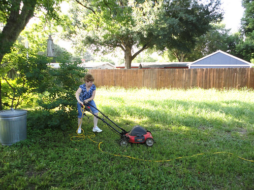 Adam's mom mowing the lawn